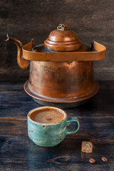 Espresso coffee  and  old kettle on a wooden board