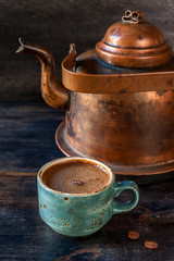 Espresso coffee and a vintage coffee pot on a wooden background