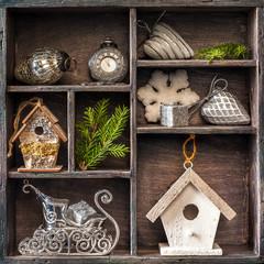 Antique clock, sleigh Santa Claus and  birdhouse. Christmas.