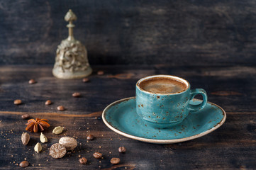 Сup of espresso coffee with spices on a vintage background