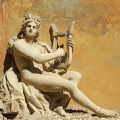 sculpture of ancient god with the lire instrument