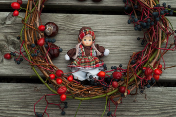 Toy doll with autumn decoration
