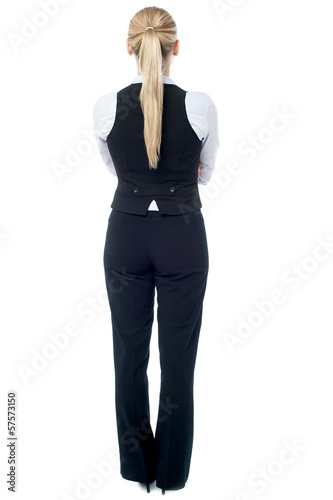 Corporate woman facing towards the wall