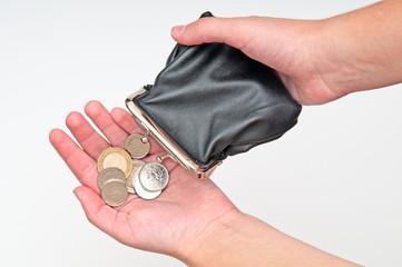 Hands holding purse and few coins