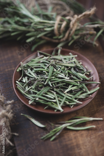 Herbs: ceramic plate with rosemary, studio shot