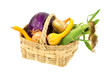 An old wicker basket filled with freshly picked vegetables