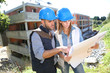 Construction engineers working together on site