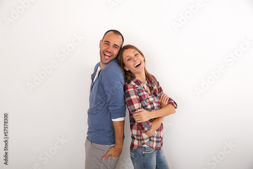 Young couple laughing outloud, isolated