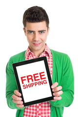 Young man holding a tablet that states free shipping