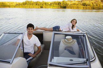 Young couple sailing with motorboat