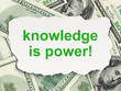 Education concept: Knowledge Is power! on Money background