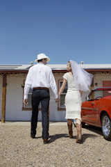 Newlyweds arriving at motel