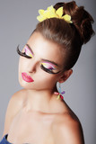 Phantasy. Fashionable Woman with Dramatic Stage Makeup. Glam