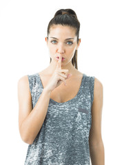 young woman asking for silence with white background