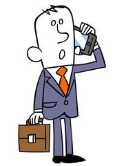 スマートフォンで話すビジネスマン