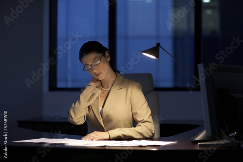 Female office worker working late