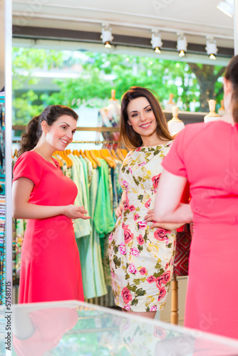 Young women shopping in fashion department store