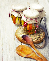 autumnal background with canned banks on wooden background