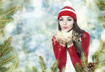 Beautiful brunette girl blowing star dust - christmas portrait