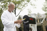 Mature man going through mail, Chatham, New Jersey, USA
