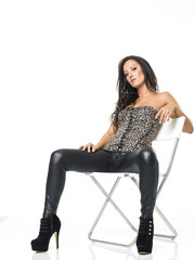 sexy rude woman in leather trousers posing