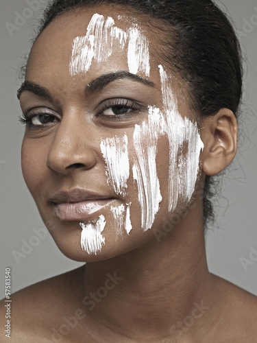 Moisturizer on young woman's face