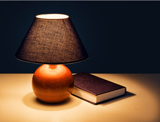 Bedtime reading - lamp with book at night