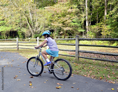 Young Girl Riding a Bicycle