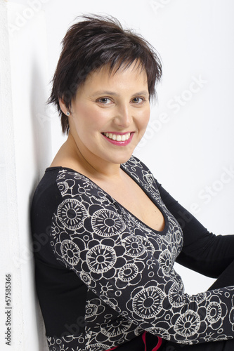 real middle aged pretty woman posing on white bacground