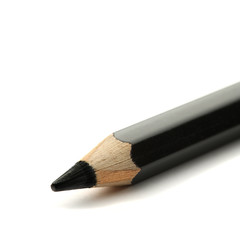 Black pencil on white background