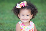 Fototapety Cute and funny latin girl with an afro hairstyle