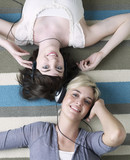 Two Young Women Listening to Headphones