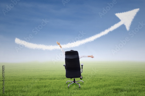 Businesswoman with up arrow sign cloud