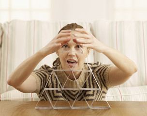 Mid-Adult Woman Building House of Cards