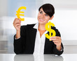 Businesswoman With Euro And Dollar Sign