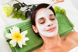 Beautiful Woman With Facial Mask At Spa