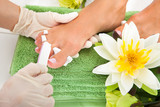 Manicurist Filing A Female Nails poster