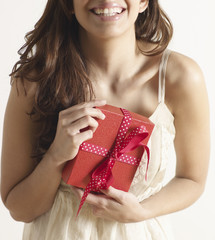 Mid-Adult Woman Holding Christmas Present