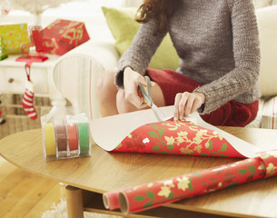 Close-Up of Woman Wrapping Christmas Presents