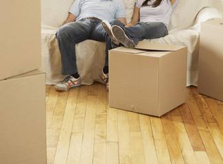 Mid-Adult Couple Resting by Boxes