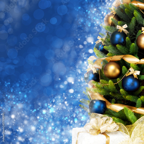 Magically decorated Christmas Tree with balls, ribbons and garla