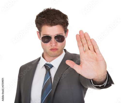 Young Businessman Showing His Hand
