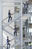 Multiple image of businessman ascending stairs in office