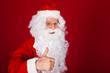Santa gesturing thumb-up