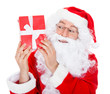 Portrait of a happy santa holding gift