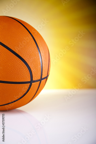 Basketball ball over  sunshine