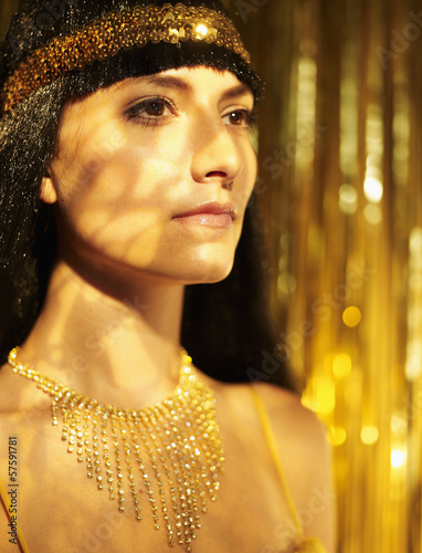 Mid-Adult Woman in Wig and Golden Jewelry