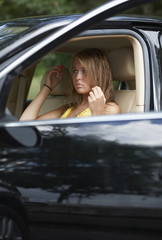 Teenage Girl Adjusting Hair in Car