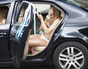 Teenage Girl Applying Make-Up in Car