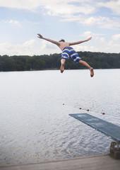 Teenage Boy Jumping into Sea